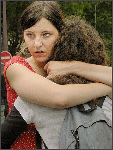 Hugging her girlfriend