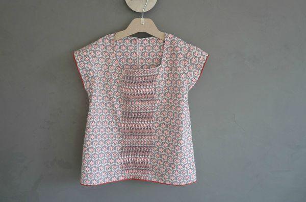 blouse à plis ondulés