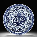 A magnificent and large imperial blue and white 'dragon' dish, qianlong seal mark and of the period