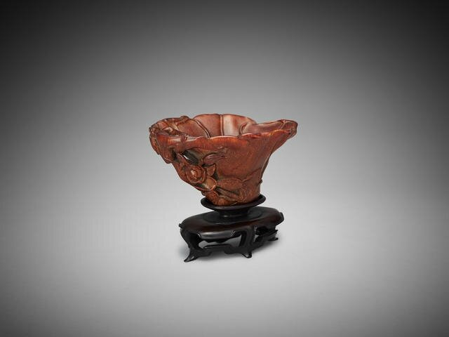 A Chinese carved rhinoceros horn 'magnolia' libation cup, 17th-18th century