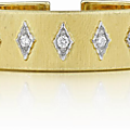 Buccellati. a diamond and gold cuff bracelet