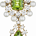 An antique peridot, natural pearl and diamond pendant/brooch