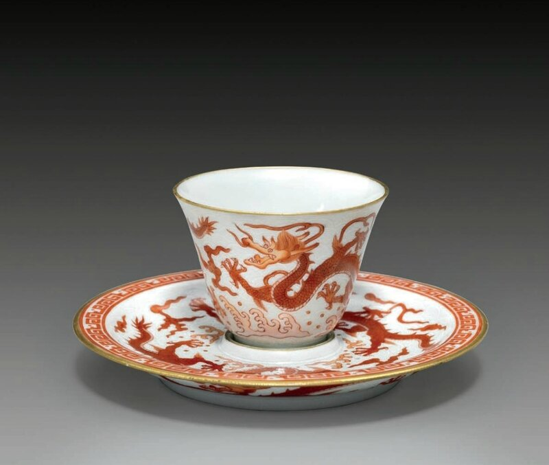 A very rare iron-red-decorated sgraffiato 'dragon' cup and saucer, Qianlong six-character marks in iron red within double squares and of the period (1736-1795)