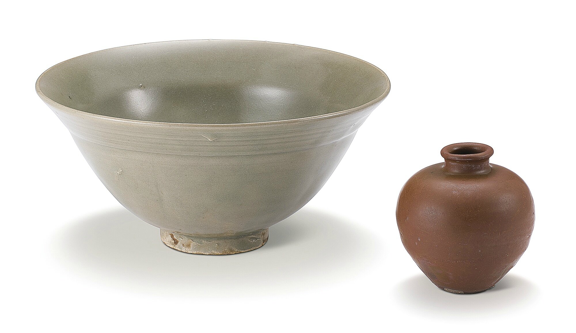 A celadon-glazed bowl and a 'Yaozhou' persimmon-glazed jar, Song Dynasty