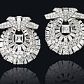 A pair of art deco diamond clip brooches, by cartier