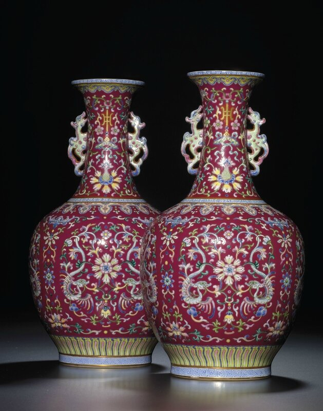 An exceptionally fine and rare pair of ruby-red groundfamille rosevases, Qianlong iron-red six-character seal marks and of the period (1736-1795)