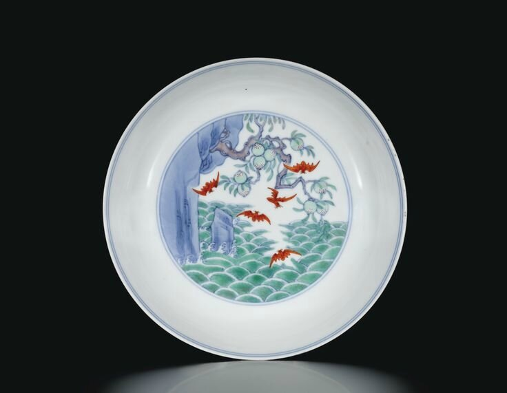 A doucai and iron-red 'Five Bats' saucer dish, Mark and period of Yongzheng