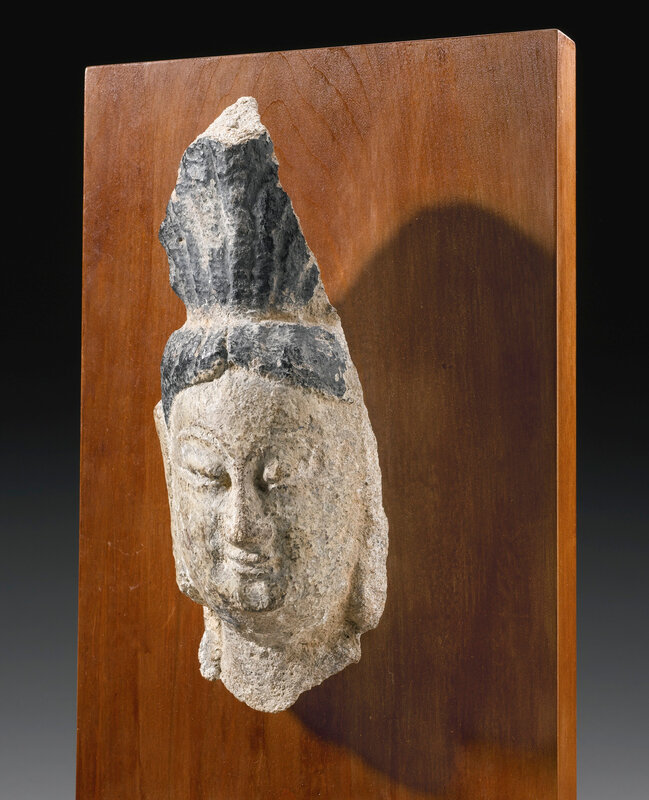 A sandstone head, Northern Wei, possibly Yungang