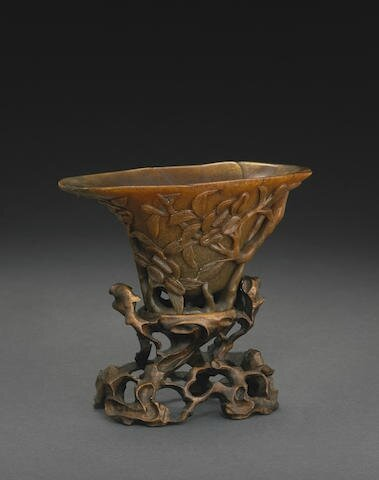 A carved rhinoceros horn libation cup, 17th-18th century