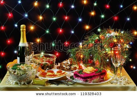 stock-photo-new-year-dinner-in-the-russian-tradition-with-lights-in-the-background-119328403