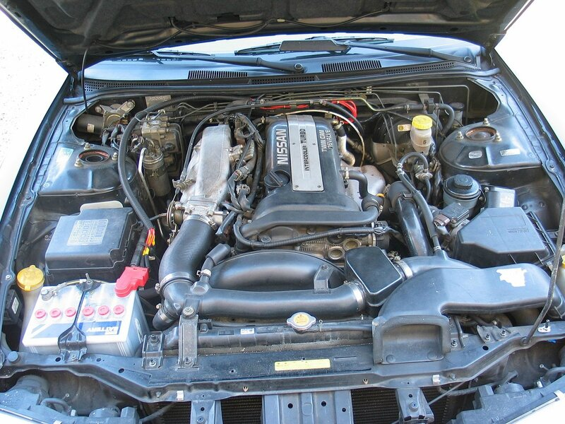1280px-Nissan_200SX_S14a_Engine_Bay_Stock