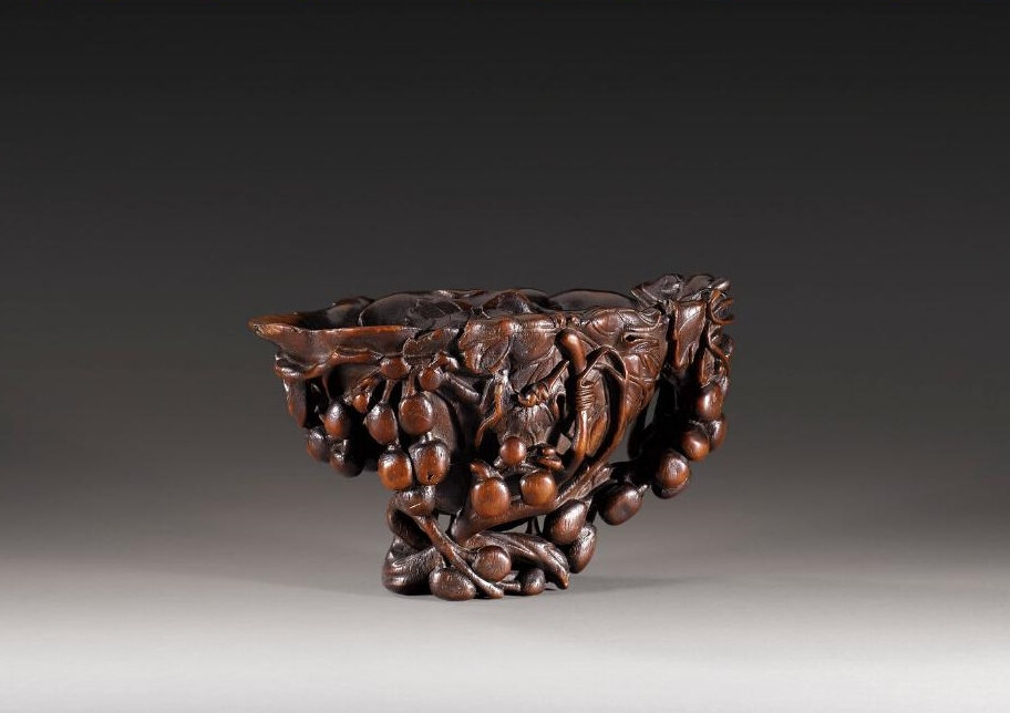 A carved rhinoceros horn libation cup, China, Qing dynasty, late 17th-early 18th century