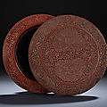 A yunnan-style carved cinnabar lacquer 'floral' circular box and cover, ming dynasty, 16th century