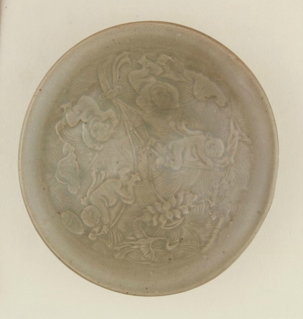 A Yaozhou carved 'Boy playing amoung lotus' bowl, Song dynasty, high 4