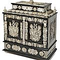 A splendid historism carved and engraved ivory mounted, ebonized cabinet, 19th century