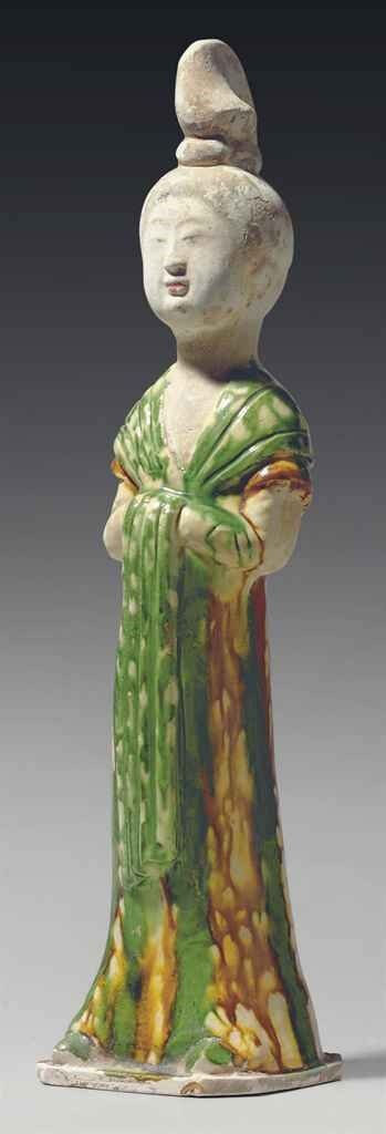 A sancai-glazed pottery figure of a court lady, Tang dynasty (618-907)