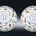 A fine pair of small doucai 'hundred bats' bowls, yongzheng six-character marks and of the period (1723-1735)