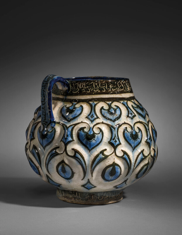 2020_CKS_18371_0004_007(a_kashan_moulded_cobalt-blue_black_and_white_jug_central_iran_early_13_d6255679)