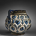 A kashan moulded cobalt-blue, black and white jug, central iran, early 13th century