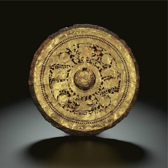 A very rare gold-inlaid iron mirror, Late Eastern Han dynasty-Early Six dynasties period