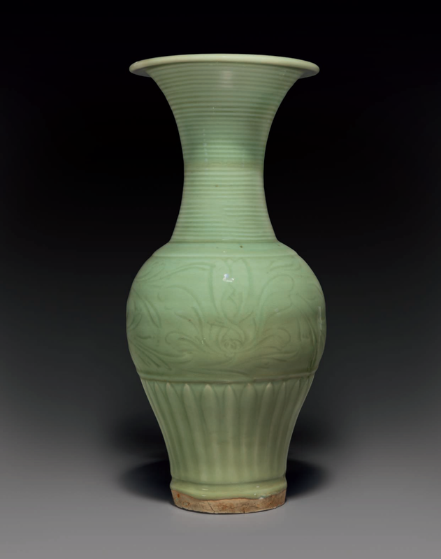 A carved Longquan celadon 'phoenix-tail' vase, Late Yuan-early Ming dynasty, 14th century