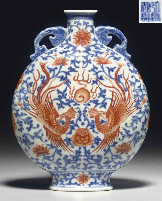 A small iron-red-decorated blue and white moonflask, Qianlong seal mark in underglaze blue and of the period (1736-1795)