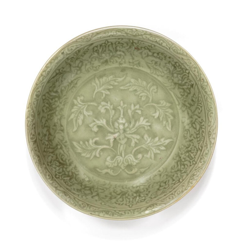 A fine carved Longquan celadon dish, Ming dynasty, 15th century