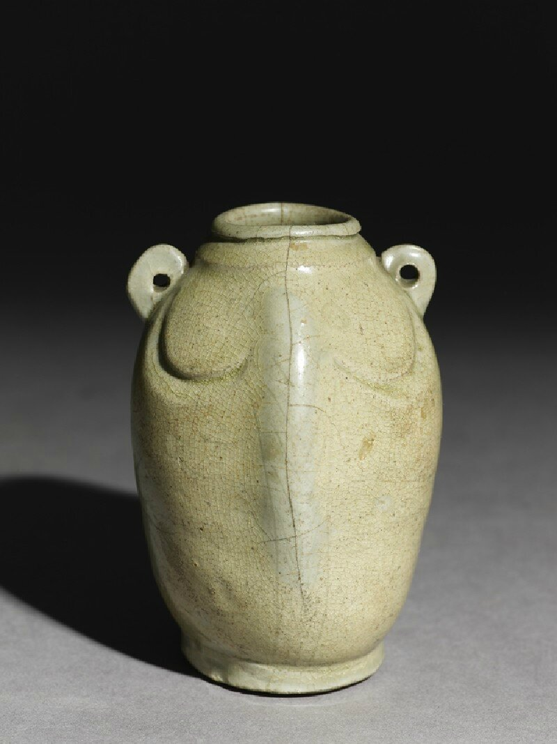 Greenware jar in the form of a double fish, Yue kiln-sites, late 9th century - early 10th century AD