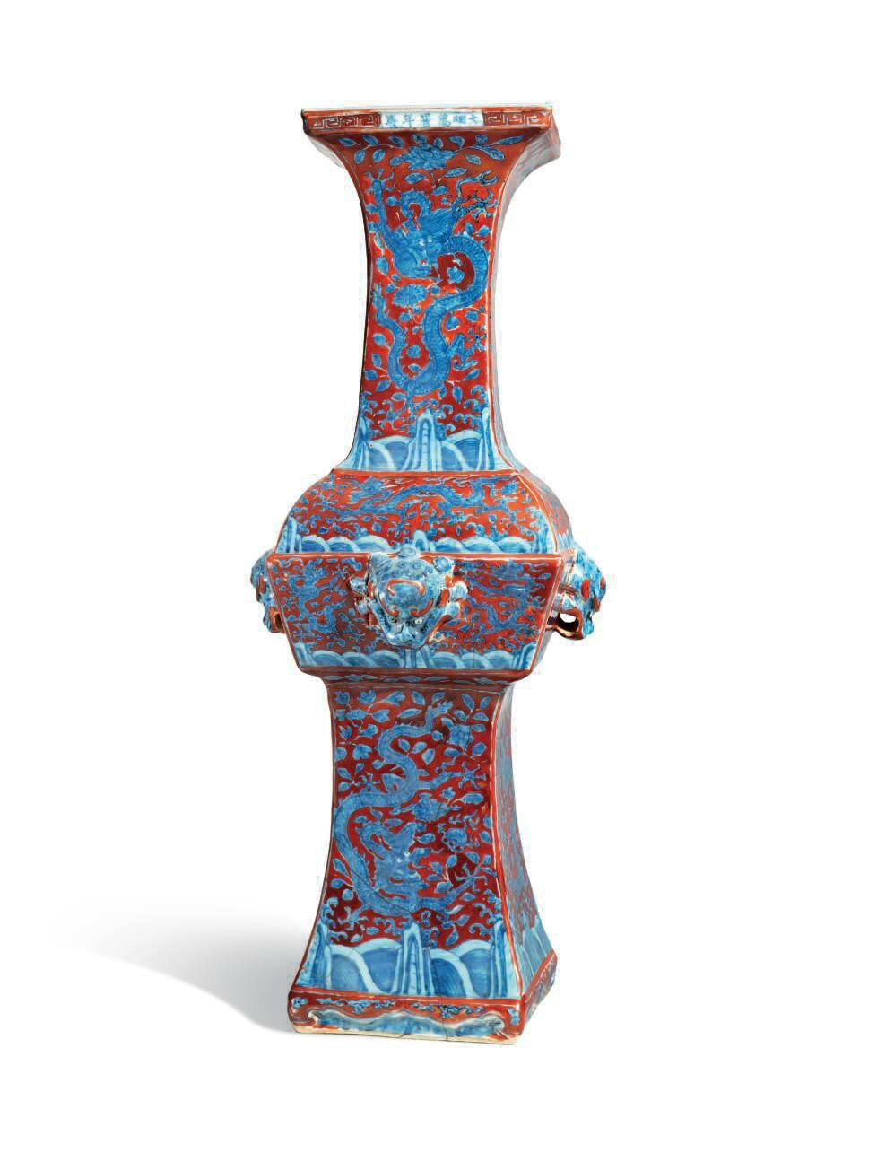 A rare iron-red and underglaze-blue decorated square-form vase, gu, Wanli six-character mark in underglaze-blue within a rectangle and of the period (1573-1620)