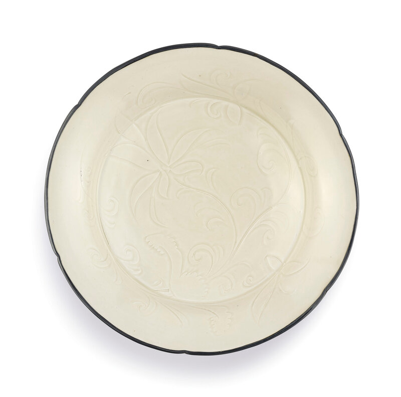 A carved lobed Dingyao 'Lotus' dish, Northern Song dynasty (960-1127)