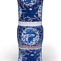 A rare relief-decorated copper-red-ground blue and white beaker vase, kangxi period (1662-1722)