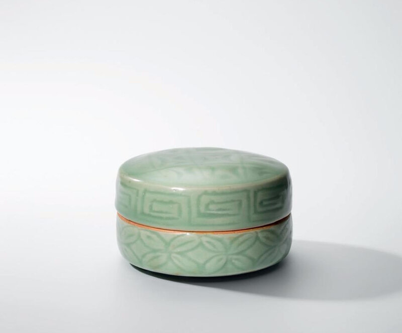 A Longquan celadon carved patterned circular box and cover, Yuan dynasty (1279-1368)