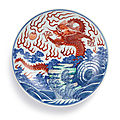 A rare doucai and iron-red 'dragon' dish, mark and period of kangxi (1662-1722)