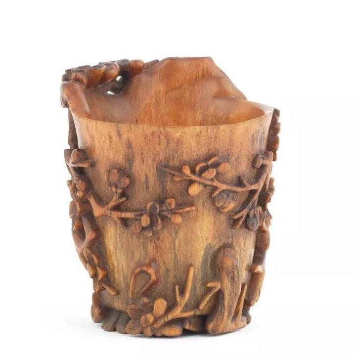 A rhinoceros horn 'prunus' libation cup, 17th/18th century