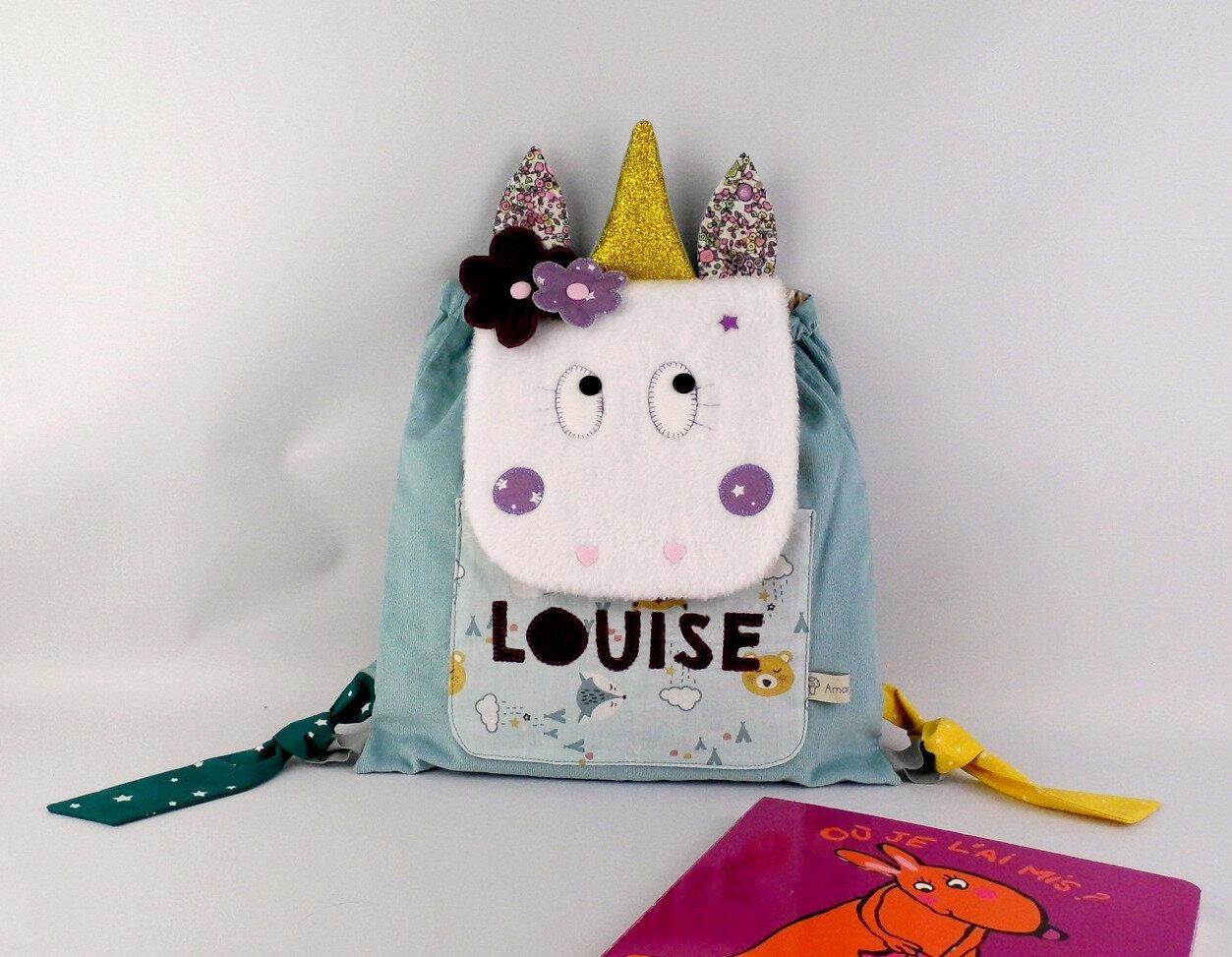 Sac à dos bébé personnalisé Louise cartable maternelle licorne mauve violet bleu cadeau naissance baptême