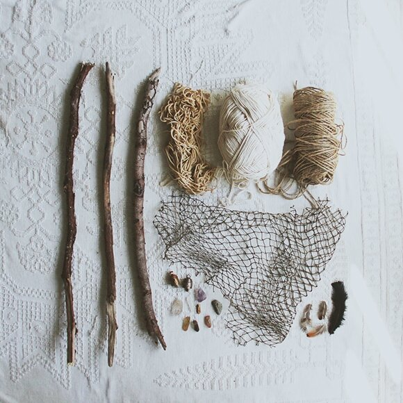 Driftwood-string-crystals-feathers-netting