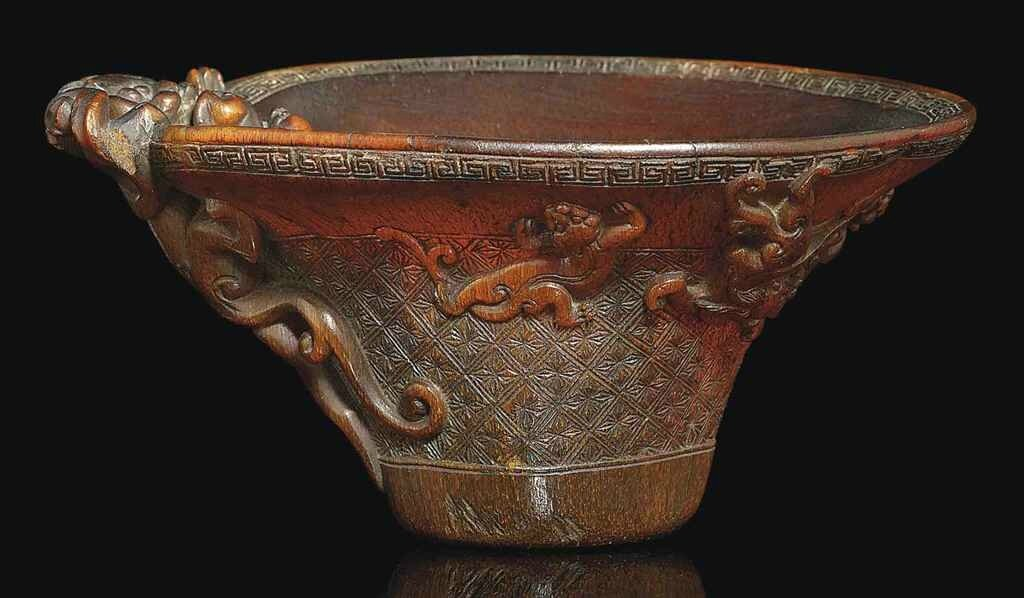 A carved rhinoceros horn 'Lotus' libation cup, 17th-18th century