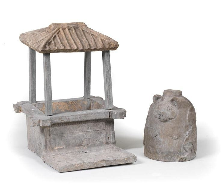 A grey pottery model of a roofed wellhead and a grey pottery bear-shaped lamp base, Han Dynasty