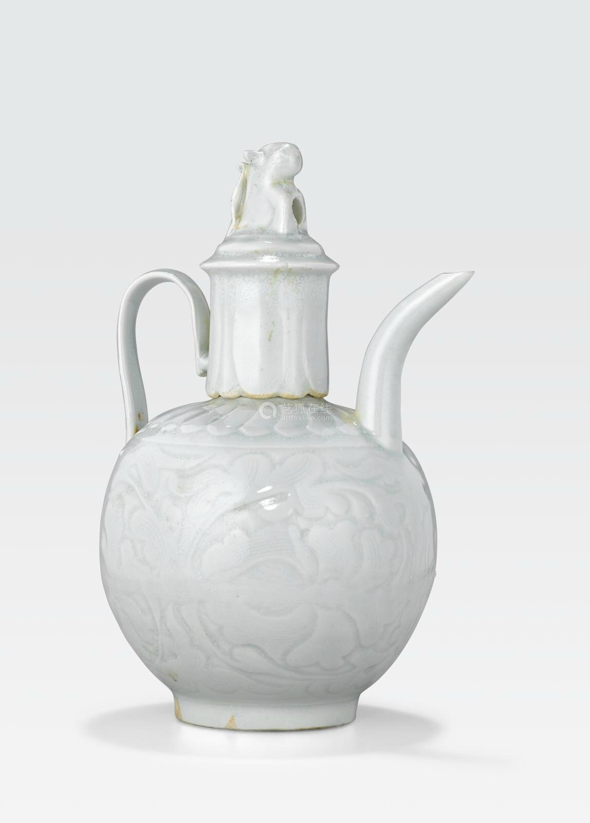 A qingbai glazed porcelain ewer with cover