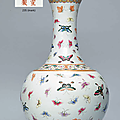 A Famille rose 'Butterfly' bottle vase, Xuantong six-character mark in iron red and of the period (1908-1911)