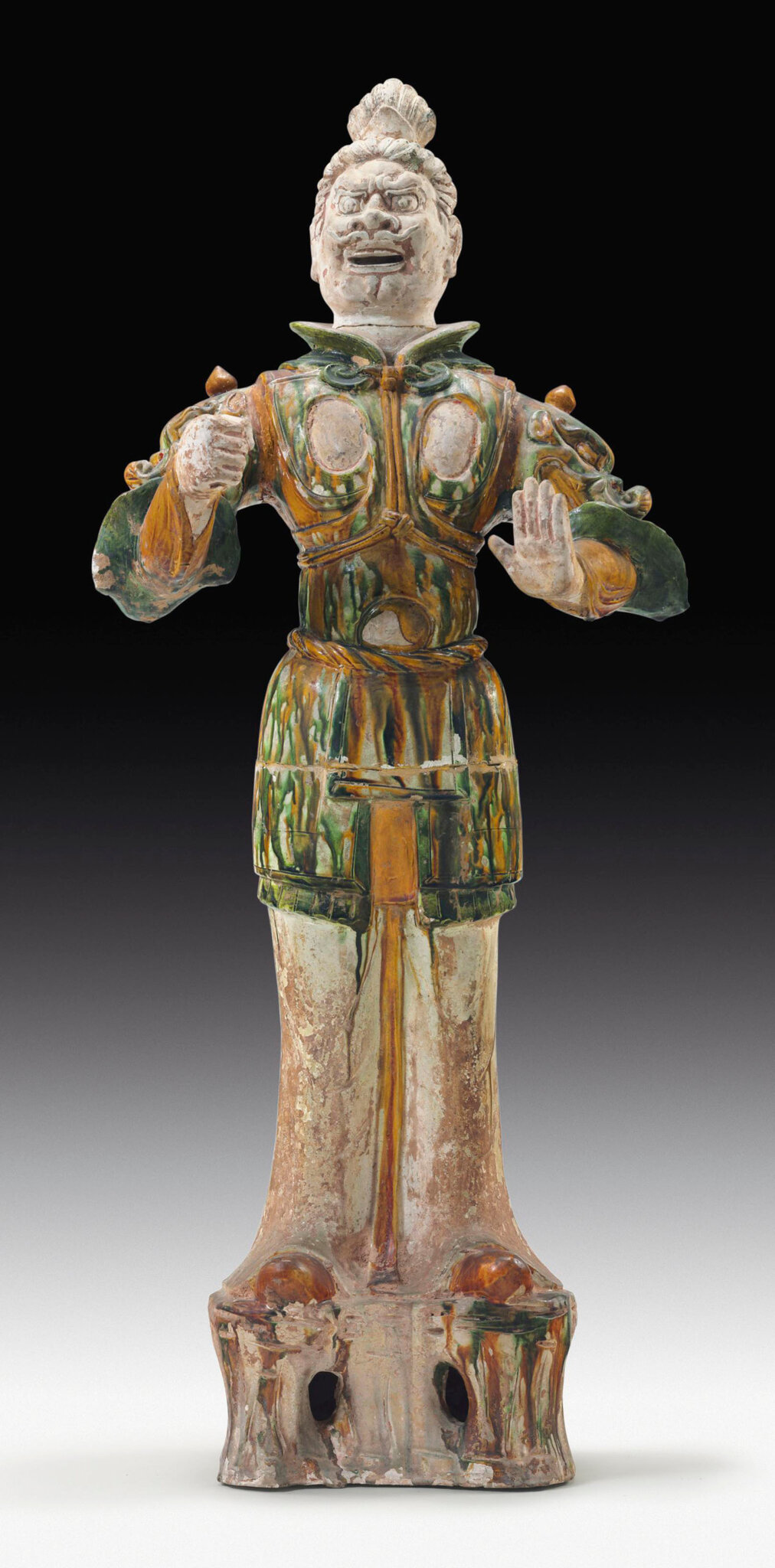 A large sancai-glazed pottery figure of a guardian, Tang dynasty (618-907)
