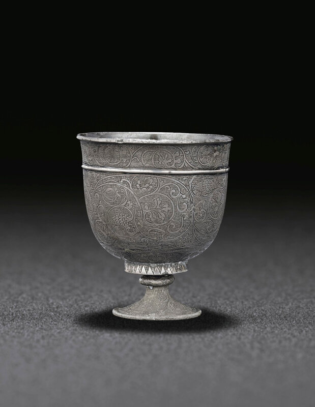 2019_NYR_18338_0545_002(a_small_finely_engraved_silver_stem_cup_tang_dynasty)