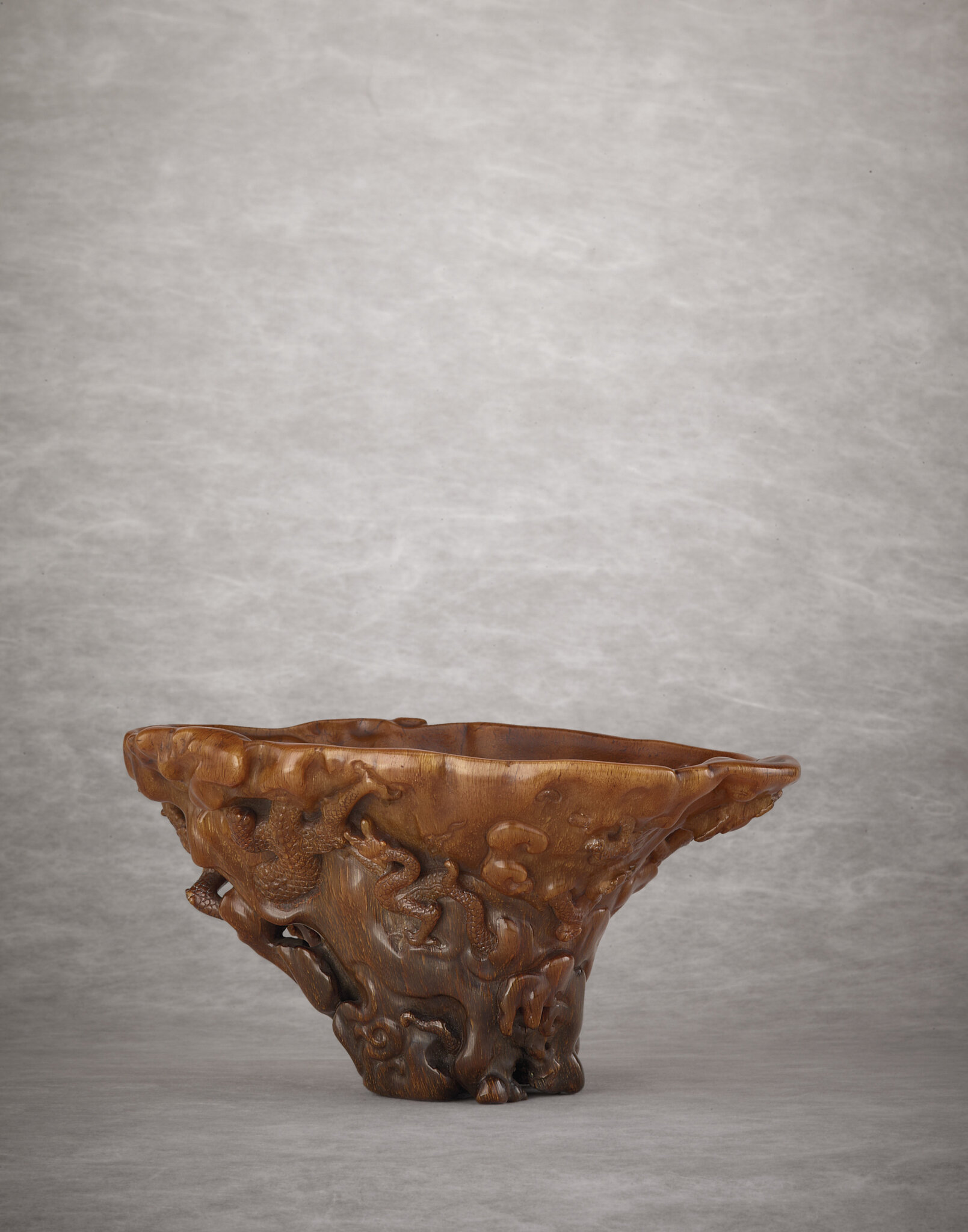 2011_HGK_02893_2907_001(a_rare_and_superbly_carved_rhinoceros_horn_dragon_libation_cup_qing_dy)