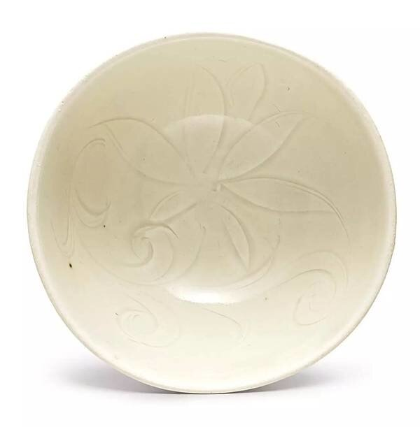 A_small_carved__Ding__white_glazed__lotus__bowl__Song_dynasty