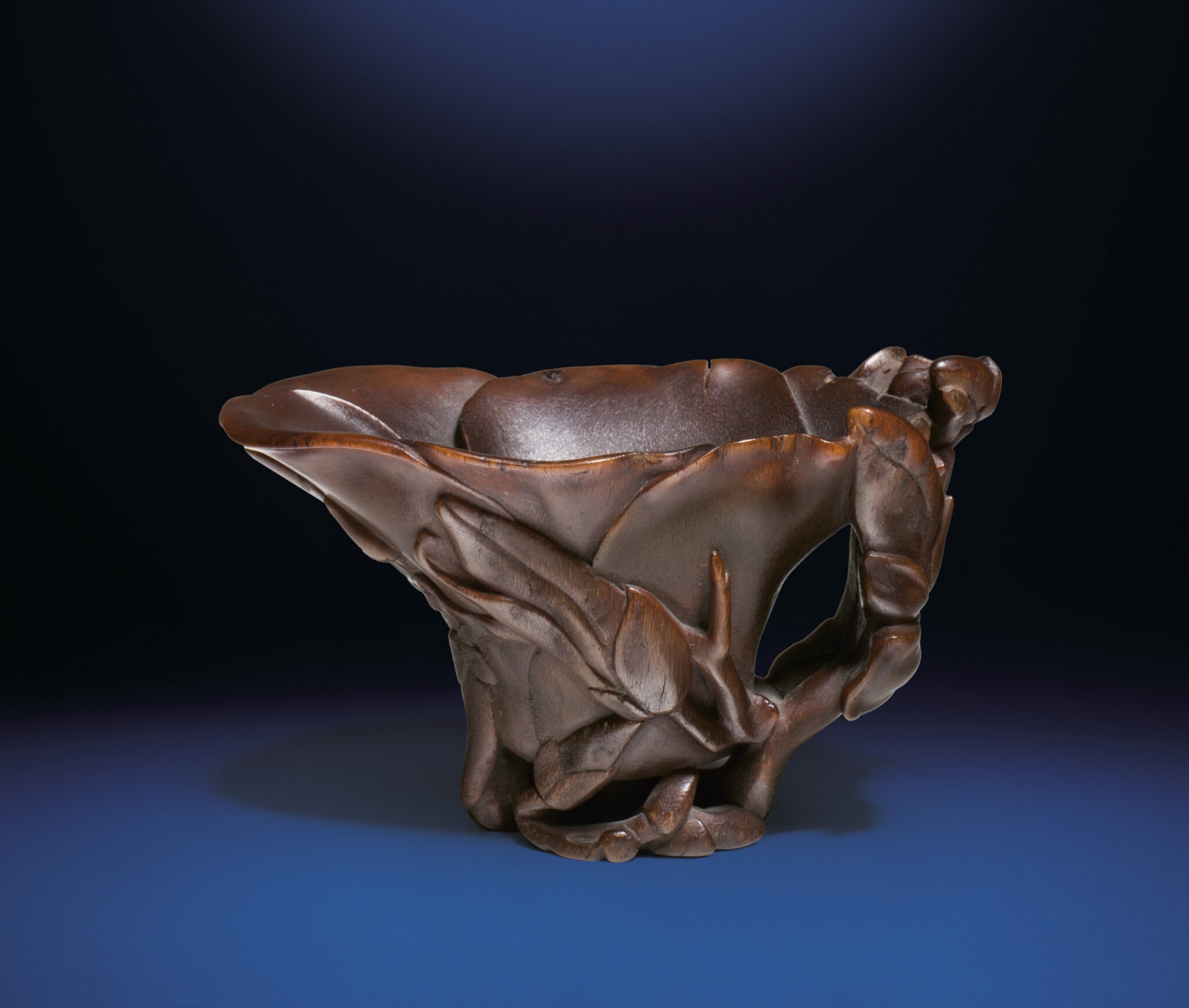 A carved rhinoceros horn 'Magnolia' libation cup, Qing dynasty, 18th century