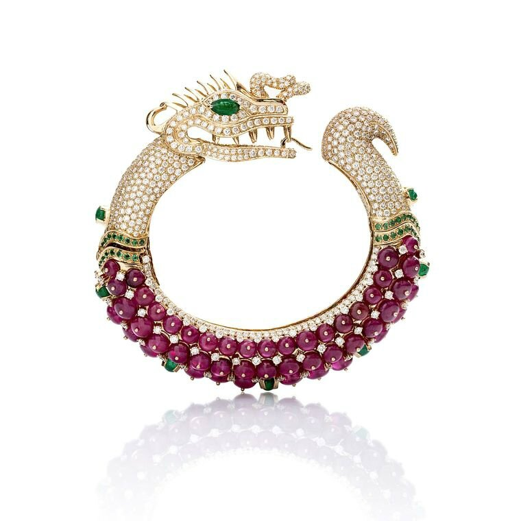 Fahra Khan_Le Jardin Exotique_A magnificent ruby Farah Khan hand cuff shaped like a dragon in 18ct yellow gold with emeralds and diamonds