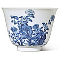 A fine blue and white 'peony' 'month' cup, kangxi mark and period (1662-1722)