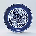 A reserve-decorated blue and white 'longevity' dish, Jiajing six-character mark in underglaze blue and of the period (1522-1566)