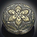 A small parcel-gilt silver circular box and cover, tang dynasty (618-907)