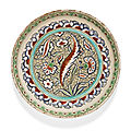 An iznik polychrome pottery dish with a wave-scroll ground, turkey, circa 1585-90